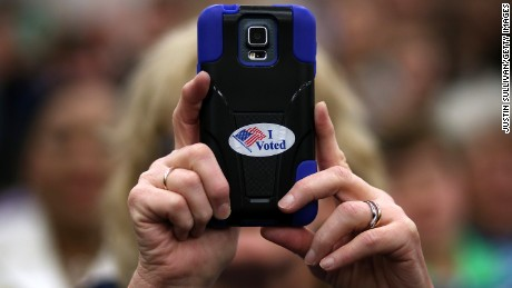 "NASHVILLE, TN - FEBRUARY 28:  A supporter uses a cell phone to take a picture as democratic presidential candidate former Secretary of State Hillary Clinton speaks during a ""Get Out The Vote"" event at Meharry Medical College on February 28, 2016 in Nashville, Tennessee. A day after defeating rival U.S. Sen. Bernie Sanders (I-VT) in the South Carolina democratic caucuses, Hillary Clinton is campaigning in Tennessee and Arkansas ahead of Super Tuesday.  (Photo by Justin Sullivan/Getty Images)"