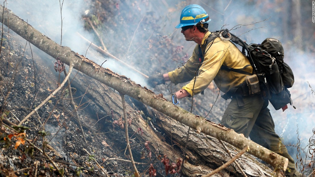 Firefighter Kevin Zimmer works the wildfire in Clayton on November 15.