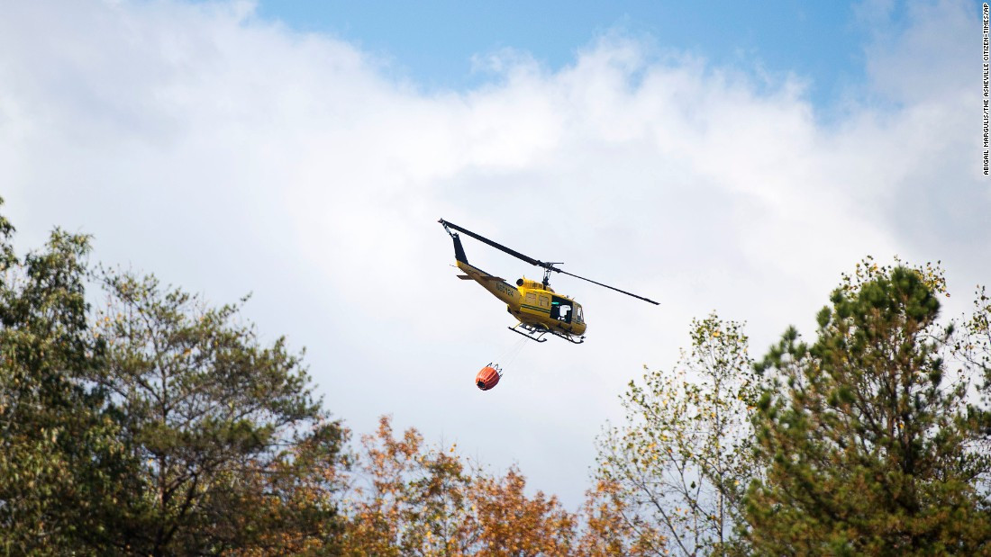 A Helicopter Carrying 240 Gallons Of Water Takes Off In Lake Lure North Carolina