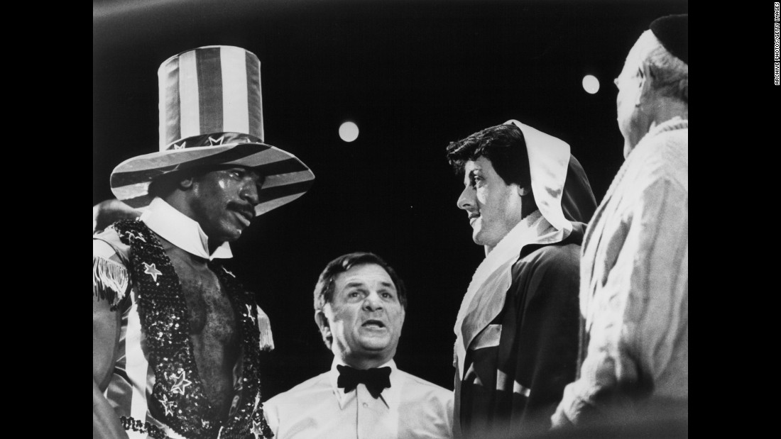 Rocky and Apollo face off before their big fight. The country was celebrating its bicentennial that year, hence the champ's Uncle Sam outfit and the fact that the fight was held in Philadelphia, where the Declaration of Independence was signed.