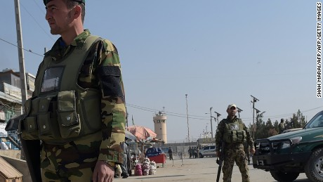 Afghan security personnel keep watch near the largest US military base in Bagram, 50 km north of Kabul, after an explosion on November 12, 2016.  Four people were killed November 12 in an explosion inside the largest US military base in Afghanistan, NATO said, with local officials blaming a suicide attacker posing as a labourer for the major security breach. / AFP / SHAH MARAI        (Photo credit should read SHAH MARAI/AFP/Getty Images)