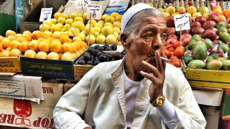 "Fruit vendor Abdel-Wareth Hassan trusts the Egyptian government saying ""the country has gotten better and cleaner since the 2011 revolution but now the government needs to get the country on track."""
