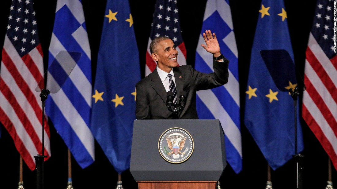 Obama waves to the crowd after delivering a speech at the Stavros Niarchos Foundation in Athens, Greece, on November 16.