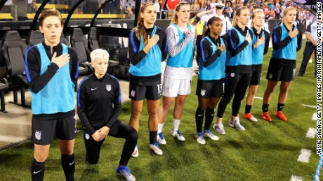 Megan Rapinoe of the U.S. Women's National Team kneels during the playing of the U.S. National Anthem before a match against Thailand on September 15 at MAPFRE Stadium in Columbus, Ohio.