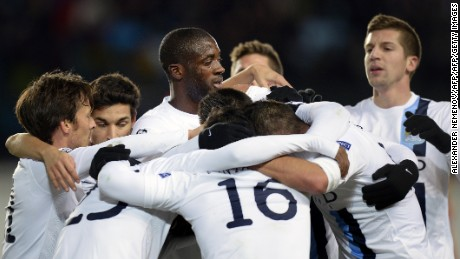 Yaya Toure (center) is surrounded by Manchester City teammates during the October, 2013 UEFA Champions League match at CSKA Moscow, where he endured racist chancts from the stands.