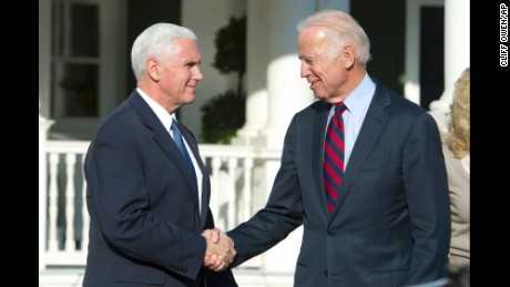 Vice President Joe Biden shakes hands with Vice President-elect Mike Pence after they had lunch at the Vice President's residence, the Naval Observatory, in Washington, Wednesday, Nov. 16, 2016. (AP Photo/Cliff Owen)