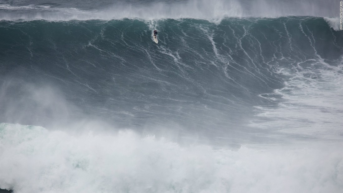 He admits there are dangers to big wave surfing and says he feels fear every time it comes to tackle the monstrous swells -- such as this one at Praia do Norte in Nazaré, Portugal.