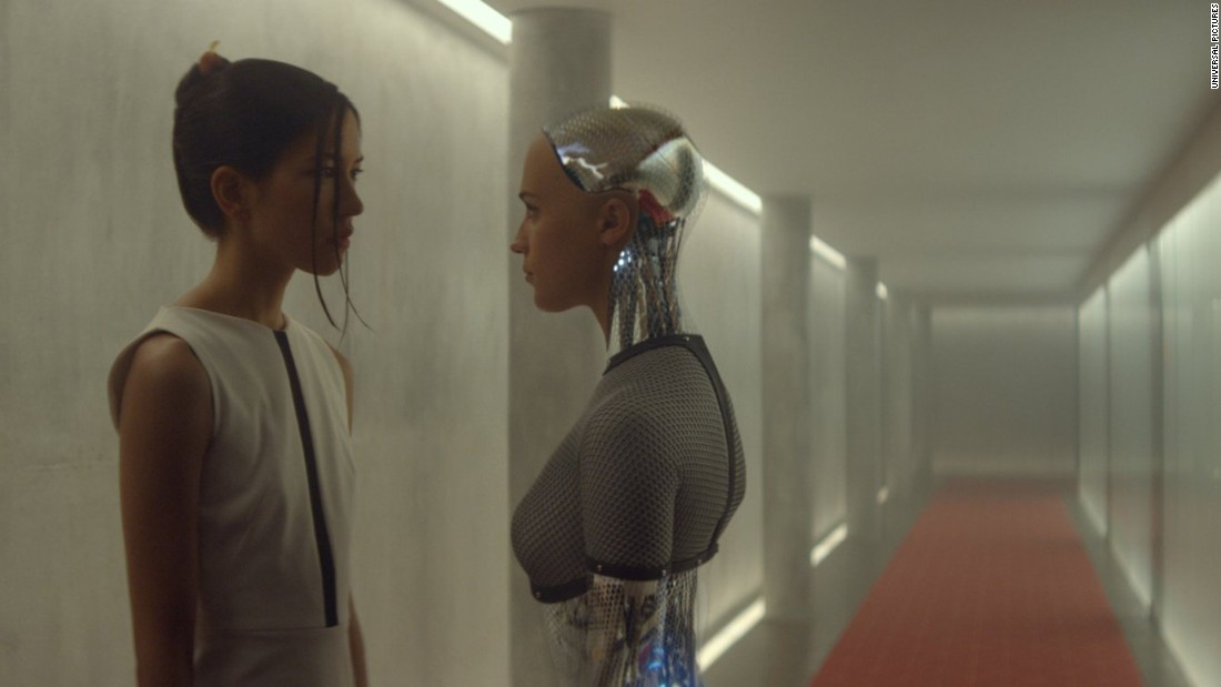 "In the film ""Ex Machina,"" Kyoko (Sonoya Mizuno, left) is a humanoid robot and servant to a software company CEO. Unlike fellow robot Ava (Alicia Vikander), she is programmed to be obedient, can't speak and does whatever her creator wishes."