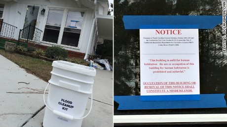 The state has left cleanup kits in driveways, but the signs on a damaged house say habitation is illegal.
