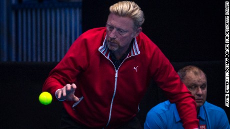 LONDON, ENGLAND - NOVEMBER 15:  Boris Becker, coach of Novak Djokovic of Serbia catches a story ball during his men's singles match against Milos Raonic of Canada on day three of the ATP World Tour Finals at O2 Arena on November 15, 2016 in London, England.  (Photo by Justin Setterfield/Getty Images)