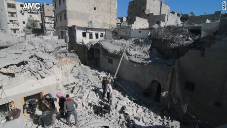 Teams work through the rubble of one of Thursday's airstrikes on Aleppo.