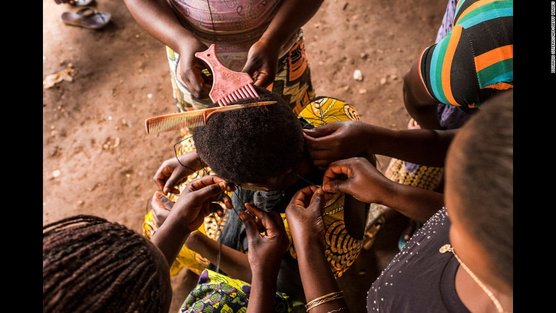 Women practice hairdressing at a vocational learning center in Butembo, Congo, on Friday, November 11.