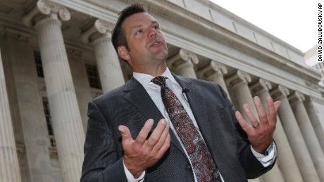 "FILE - In this Aug. 23, 2016 file photo, Kansas Secretary of State Kris Kobach responds to questions outside the 10th U.S. Circuit Court of Appeals in Denver. A federal appeals court says ""no constitutional doubt arises"" that federal law prohibits Kansas from requiring citizenship documents from people who register to vote at motor vehicle offices. The ruling handed down late Friday evening, Sept. 30, 2016, upholds U.S. District Judge Julie Robinson's temporary order forcing Kansas to register more than 20,000 voters. The decision is the latest setback for Kobach.  (AP Photo/David Zalubowski, File)"
