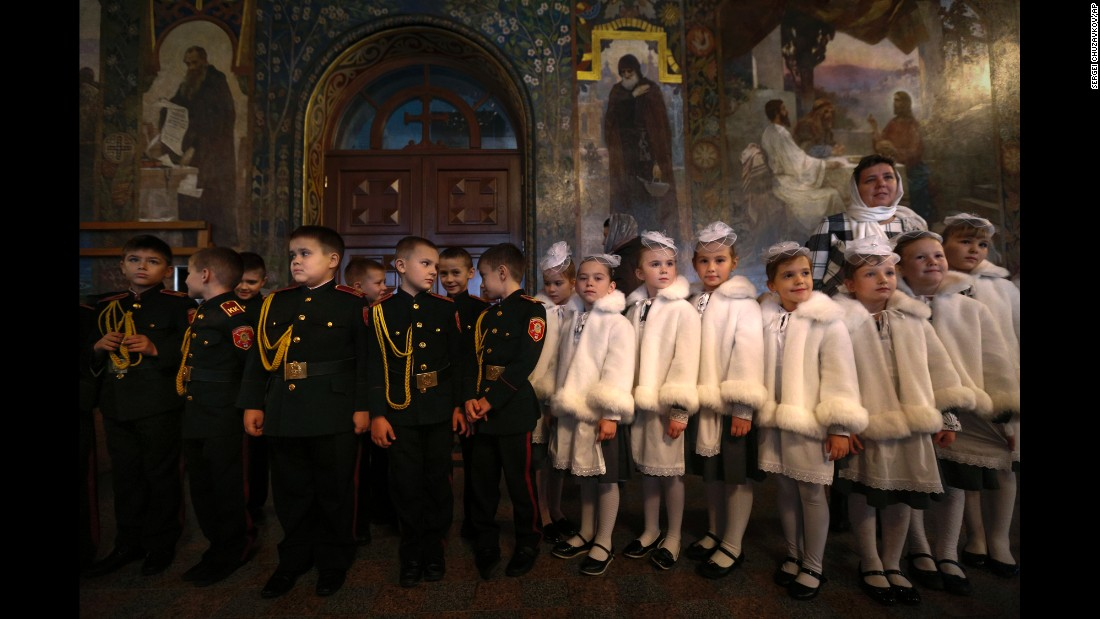 Boys and girls dressed in cadet school uniforms attend a ceremony in Kiev, Ukraine, on Friday, November 11.