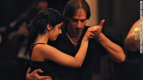 "A couple dance tango in a Milonga during the 2009 Montevideo International Tango Festival on February 13, 2009 in Montevideo. Six tango professor couples from Uruguay and Argentina gave 30 lessons and shared four nights of ""Milongas"" - an event where tango is danced. AFP PHOTO/Pablo PORCIUNCULA (Photo credit should read PABLO PORCIUNCULA/AFP/Getty Images)"