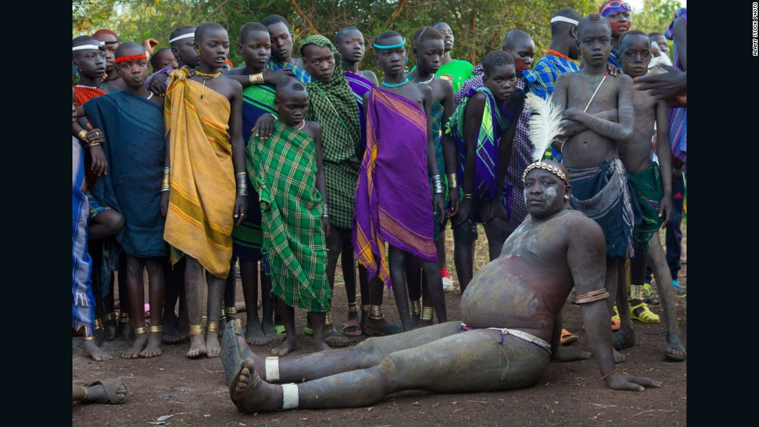 "Every June or July in the Omo Valley, Ethiopia, the <em>Ka'el</em> -- the Bodi lunar new year -- takes place. With it comes an extraordinary show of pageantry. In the months before the event men live in isolation and drink to excess <a href=""/2015/10/02/africa/milk-big-business-africa/index.html"" target=""_blank"">a mixture of cow milk and cow blood</a> for months in order to become vastly bloated and overweight. Each clan will then present an unmarried male to compete for the title of fattest man -- and with the glory, the greater chance of finding a wife. With stomachs swollen, balance and fatigue can be an issue, but once the event is over, contestants return to their normal size in a matter of weeks."