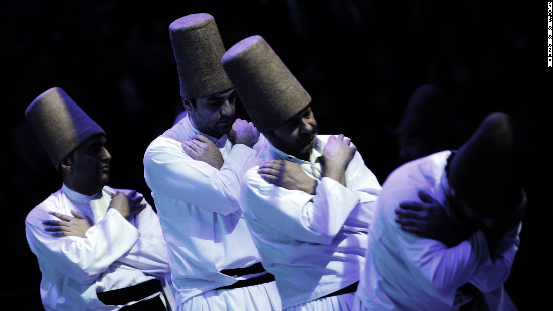 "Whirling dervishes salute a ""Postisin"", leader of the troupe, at the end of a ceremony marking the anniversary of the death of Rumi."