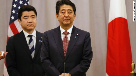 Japanese Prime Minister Shinzo Abe, right, listens to questions from members of the press after meeting with President-elect Donald Trump, Thursday, Nov. 17, 2016, in New York. Abe made a stop in New York to meet with the president-elect while en route to an APEC meeting in Lima. (AP Photo/Kathy Willens)