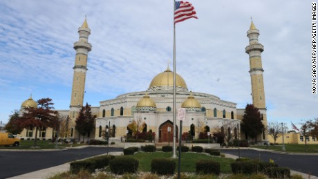 A US national flag is seen in front of the Islamic Center of America in Dearborn, Michigan on November 9, 2016.    This Detroit suburb is home to one of the biggest populations of Muslims and Arabs in the United States, and Musid was among many in her community trying to make sense of the brash Republican's election. Across the country, Muslim Americans are now wondering what a Trump presidency might mean, said Hazem Bata, head of the Islamic Society of North America, a national advocacy group.  / AFP / Nova SAFO        (Photo credit should read NOVA SAFO/AFP/Getty Images)