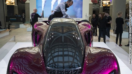 LOS ANGELES, CA - NOVEMBER 17: A man polishes a 3D printed car made by Divergent 3D, which is claimed to be a more environmentally friendly and cost effective way to build cars, is displayed during the four-day auto trade show AutoMobility LA at the Los Angeles Convention Center on November 17, 2016 in Los Angeles, California. AutoMobility LA precedes the ten-day LA Auto Show, open to the public November 18 through 27.  (Photo by David McNew/Getty Images)