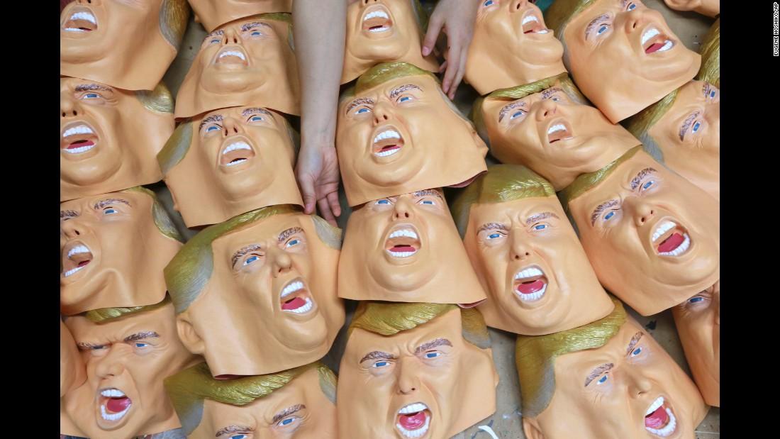 Rubber masks depict Trump in Saitama, Japan, on Tuesday, November 15.