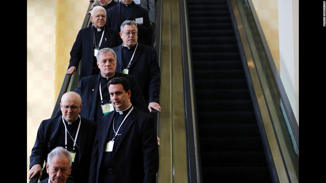 Members of the United States Conference of Catholic Bishops ride an escalator during the group's annual fall meeting in Baltimore on Monday, November 14. The bishops opened their meeting by urging the President-elect to adopt humane policies toward immigrants and refugees.