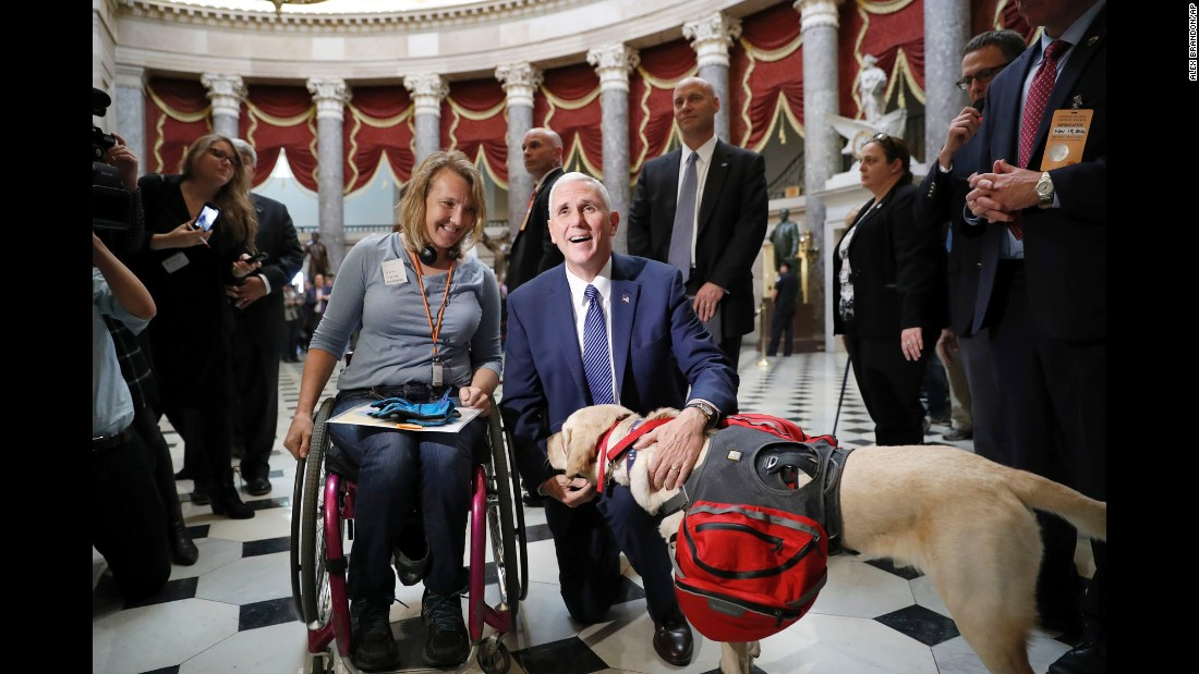 Vice President-elect Mike Pence greets Christine Slavin and her dog Earle between meetings on Capitol Hill on Thursday, November 17.