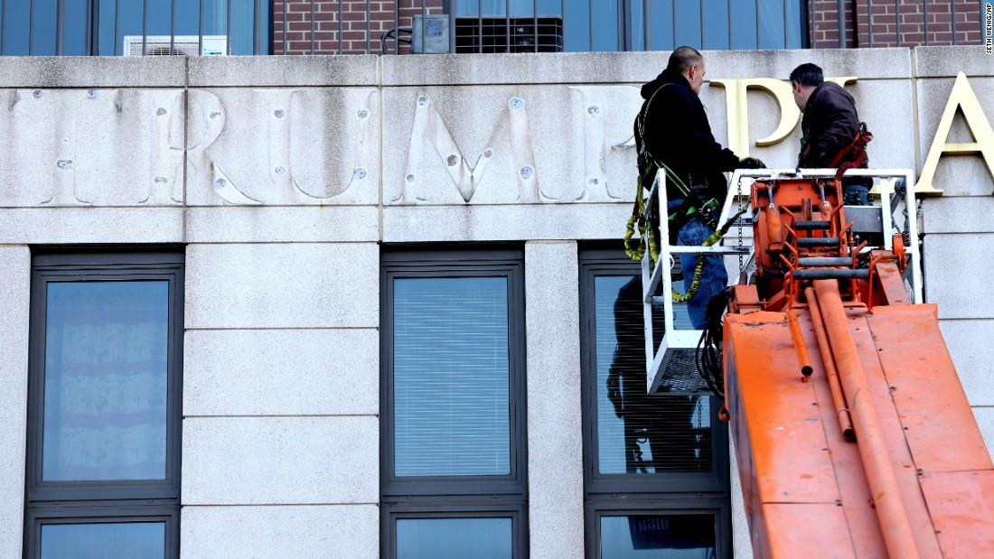 "Letters are removed from a Trump Place high rise in New York on Wednesday, November 16. ""Trump Place"" signs <a href=""http://money.cnn.com/2016/11/16/news/companies/trump-place-name-change/"" target=""_blank"">were removed</a> from three apartment buildings along the Hudson River in Manhattan. They are being renamed with just their street addresses. The Trump Organization sold the buildings more than a decade ago to Equity Residential, a Chicago-based real estate company. The company's chairman told CNBC that the company just wants to be politically neutral."