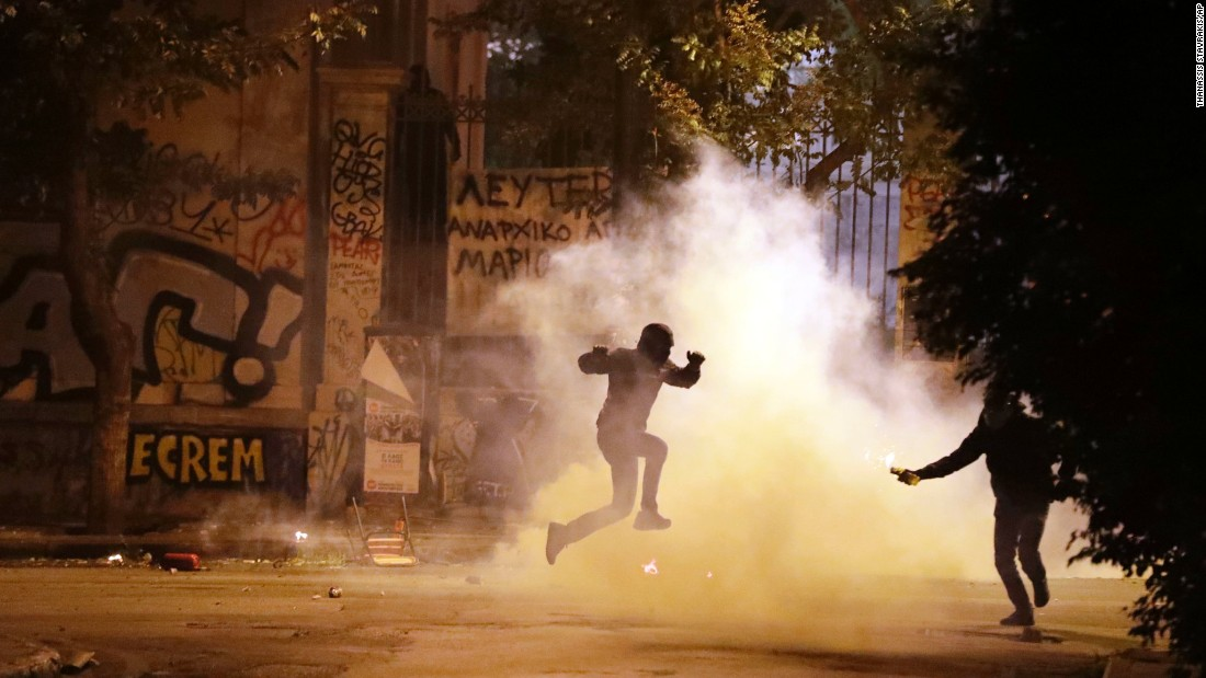 "A protester jumps to avoid tear gas during <a href=""http://www.cnn.com/2016/11/16/europe/greece-athens-obama-protests/"" target=""_blank"">an anti-capitalism protest</a> in Athens, Greece, where US President Barack Obama was visiting on Tuesday, November 15. Six people were arrested after a group of anarchists started throwing rocks and Molotov cocktails, Athens police told CNN."