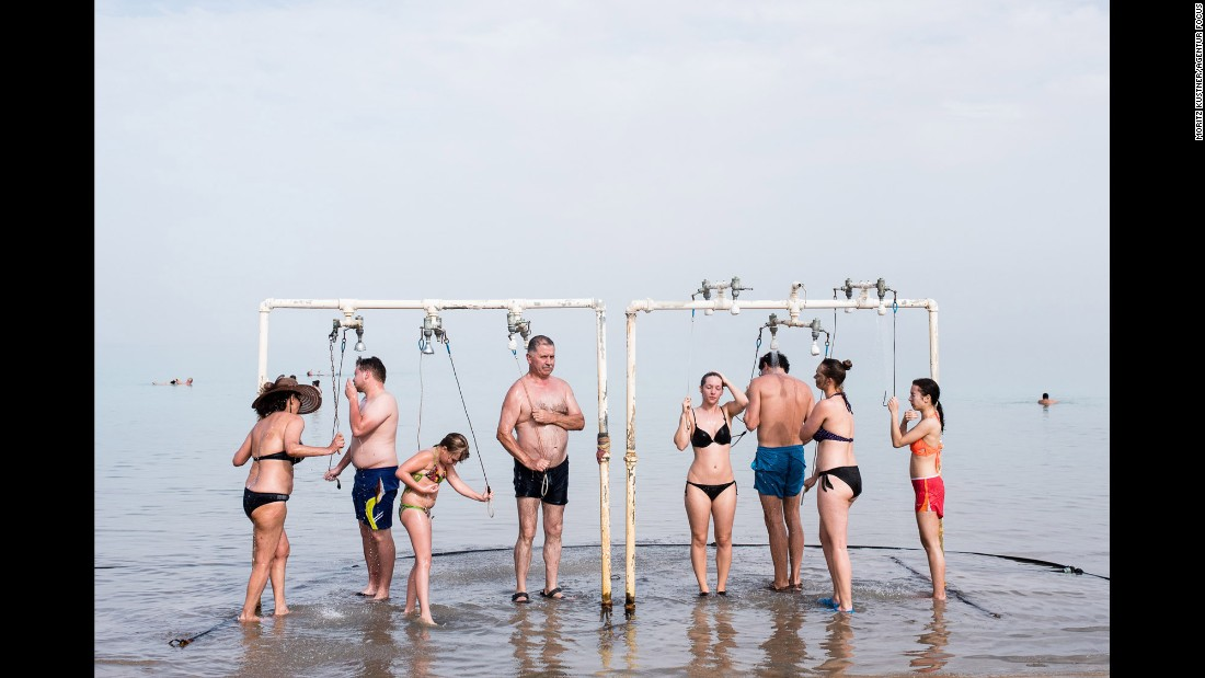 Tourists shower at a Dead Sea resort to remove salt water from their skin. The Dead Sea, which borders Israel, Jordan and the West Bank, is one of the saltiest bodies of water in the world. People flock to it for its healing properties, but it's shrinking at an alarming rate.