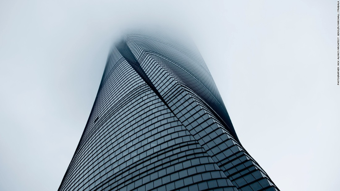 "At 632-meters tall, Shanghai Tower, located in the city's Pudong district, is presently China's tallest building and the second tallest in the world. Bangkok-based photographer <a href=""http://www.almasyphotography.com/"" target=""_blank"">Nick Almasy</a> took this photo of the skyscraper, which was also the world's tallest twisted tower in 2016, soaring into the mist."
