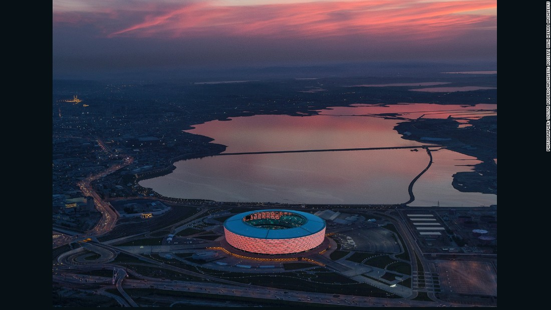 "This 68,000-seat stadium in Azerbaijan served as the main venue for the opening and closing ceremonies of the 2015 European Games. Spanish photographer <a href=""http://www.vromero.com/"" target=""_blank"">Victor Romero</a> captured the illuminated structure at night."
