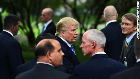 US Republican presidential nominee Donald Trump (C) is surrounded by members of the Secret Service as he visits the tomb of former US President Gerald Ford in Grand Rapids, Michigan, on September 30, 2016.