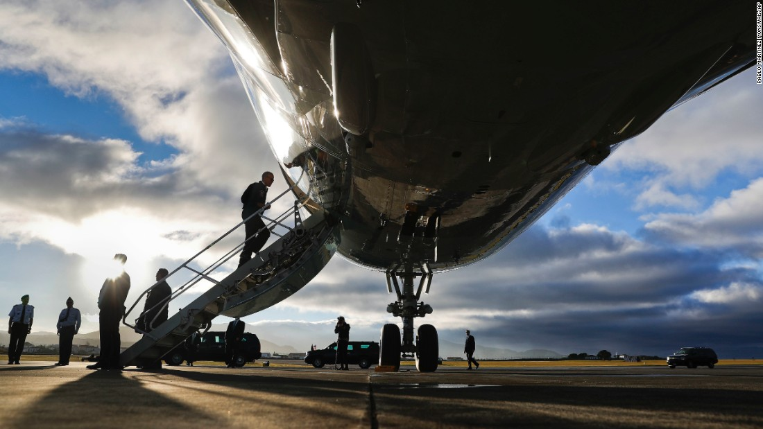 On his way to Peru, Obama boards Air Force One during a refueling stop in the Azores on November 18.