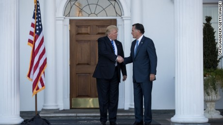 President-elect Donald Trump shakes hands with Mitt Romney after their meeting at Trump International Golf Club, November 19, 2016 in Bedminster Township, New Jersey.