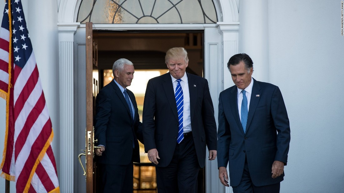 Trump is flanked by Pence, left, and  Romney after a meeting in Bedminster Township, New Jersey, on Saturday, November 19.