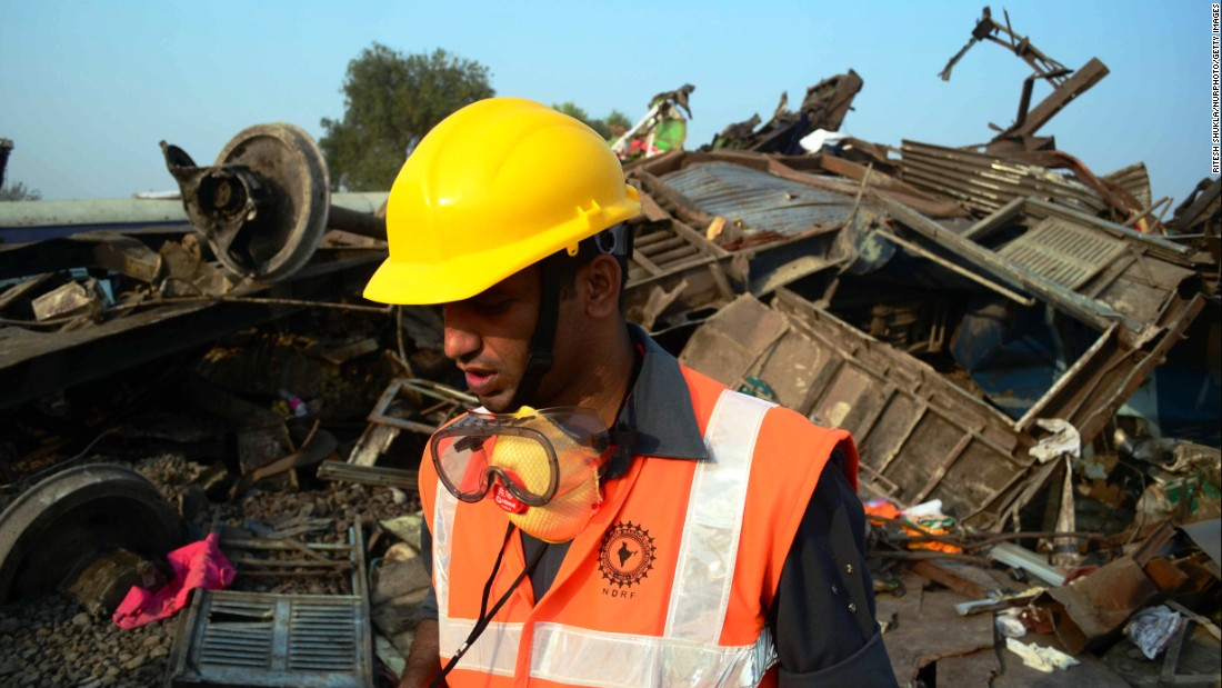 A National Disaster Response Force employee works at the derailment site in Pukhrayan.