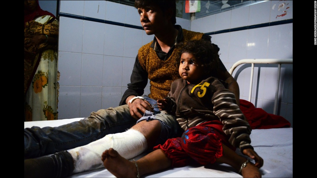 With her uncle at her side, a 2-year-old passenger of the derailed train gets admitted to a hospital in Pukhrayan.