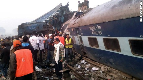 Indian rescue workers search for survivors in the wreckage of a train that derailed near Pukhrayan in Kanpur district on November 20, 2016. A passenger train derailed in northern India on November 20, killing at least 63 travellers most of whom were sleeping when the fatal accident occurred, police said. Rescue workers rushed to the scene near Kanpur in Uttar Pradesh state where the Patna-Indore express train derailed in the early hours of the morning.  / AFP / -        (Photo credit should read -/AFP/Getty Images)