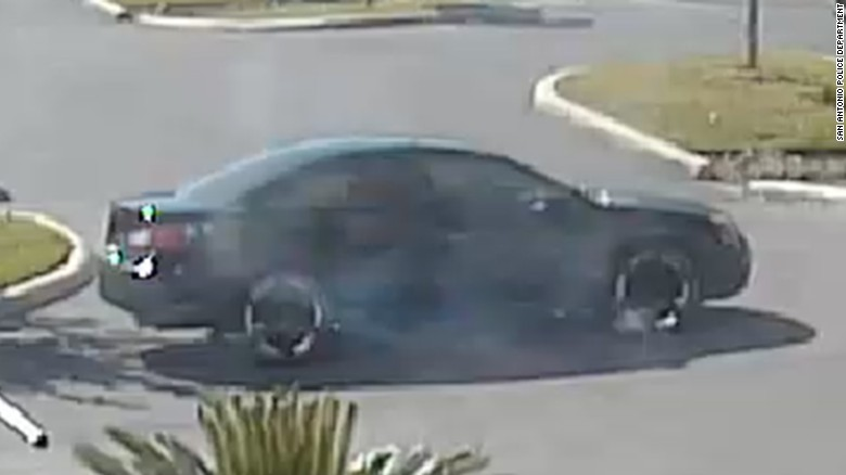 San Antonio police are looking for the person who drove the car away from a police shooting.