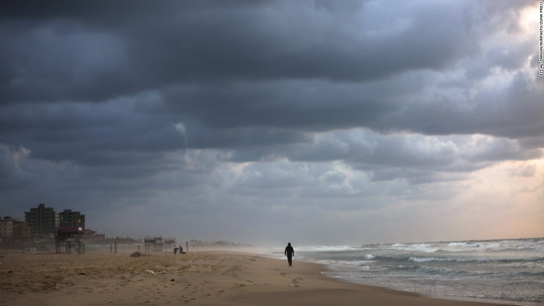 A lone figure is silhouetted against a brooding sky in Gaza. The war-torn territory is hoping to build a tourism industry that will make it a travel hub in the Middle East.