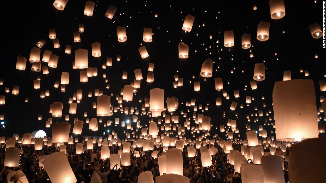 Thousands of paper lanterns rise above Chiang Mai, Thailand, to mark the annual Yi Peng festival. Authorities in Thailand have eased curbs on celebrations following a strict mourning period for late King Bhumibol Adulyadej.