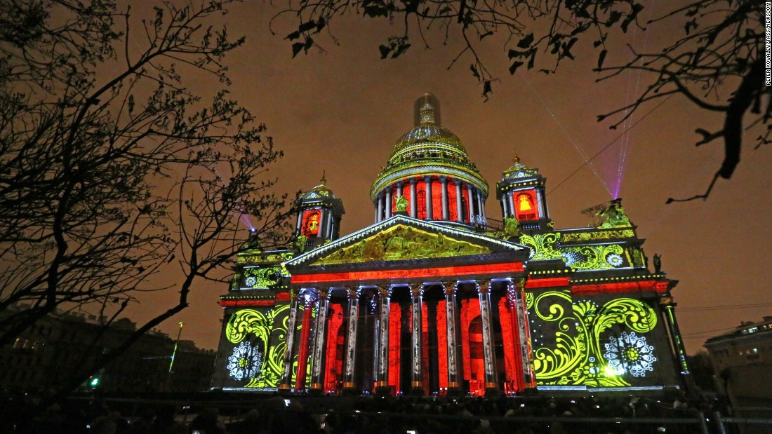 A projection is mapped onto the facade of St Isaac's Cathedral in St Petersburg. The Orthodox cathedral's 21.8 meter dome dominates the skyline of the Russian city.<br />