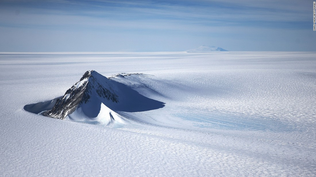 An Antarctic mountain stands in stark relief against the wastes of the West Antarctic Ice Sheet. NASA's Operation Ice Bridge is gauging the rate of decline of ice cover caused by global warming.<br />