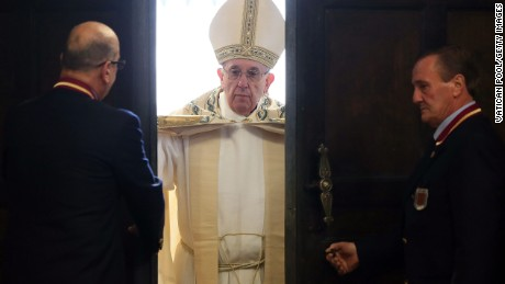 VATICAN CITY, VATICAN - DECEMBER 08:  Pope Francis opens the Holy Door of St. Peter's Basilica on December 8, 2015 in Vatican City, Vatican. During the solemnity of the Immaculate Conception of the Blessed Virgin Mary, Pope Francis solemnly inaugurated the Jubilee Year of Mercy with the celebration of the Holy Sacrifice of the Mass. This Extraordinary Holy Year is itself a gift of grace,' the Pope said in his homily.  (Photo by Vatican Pool/Getty Images)