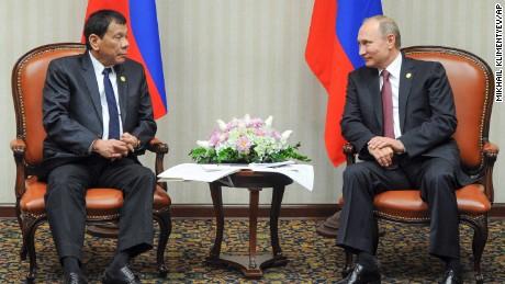 Philippine President Rodrigo Duterte, left, listens to Russian President Vladimir Putin during their meeting at the Asia-Pacific Economic Cooperation (APEC) forum in Lima, Peru, Saturday, Nov. 19, 2016.