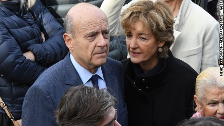 Alain Juppe with his wife Isabelle Juppe at a polling station in Bordeaux on November 20, 2016.