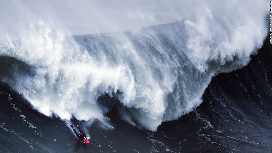 A bodyboarder takes part in a big-wave surfing session in Nazare, Portugal, on Saturday, November 19.