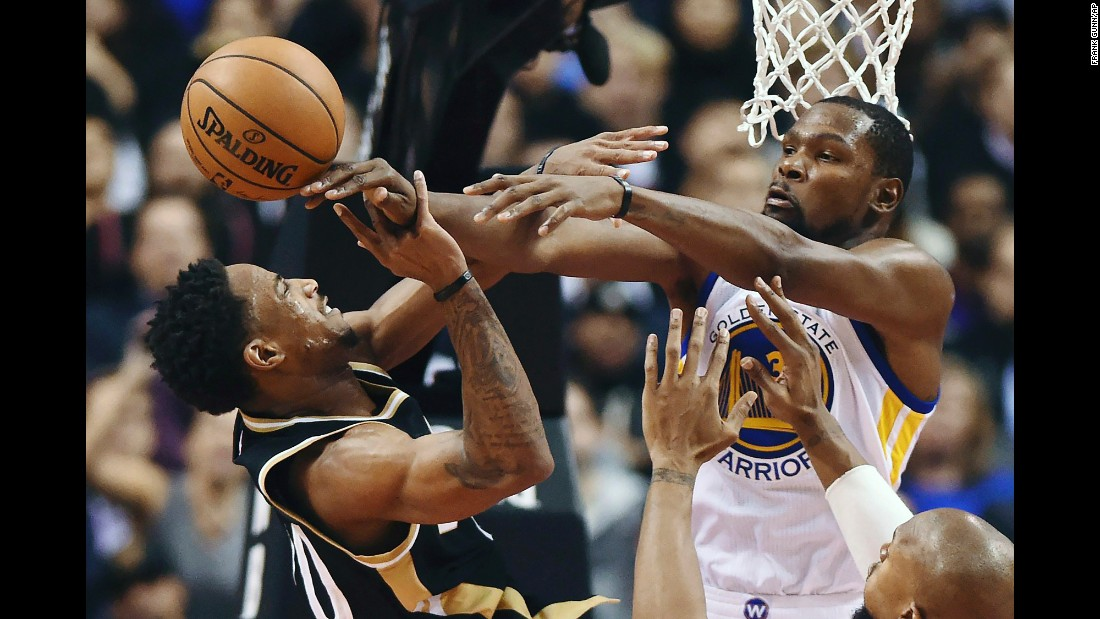 Toronto's DeMar DeRozan is fouled by Golden State's Kevin Durant during an NBA game in Toronto on Wednesday, November 16. DeRozan scored 34 points, becoming the first NBA player since Michael Jordan to score 30 points in the first 11 games of the season. But Durant and the Warriors won 127-121.