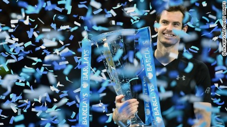 TOPSHOT - Britain's Andy Murray celebrates with the trophy after winning the men's singles final on the eighth and final day of the ATP World Tour Finals tennis tournament in London on November 20, 2016. / AFP / Glyn KIRK        (Photo credit should read GLYN KIRK/AFP/Getty Images)